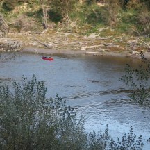 Cosy kayakers on the river.